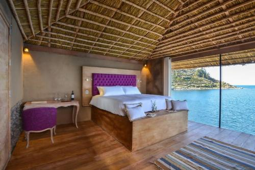 A bed or beds in a room at Amantica Lodge