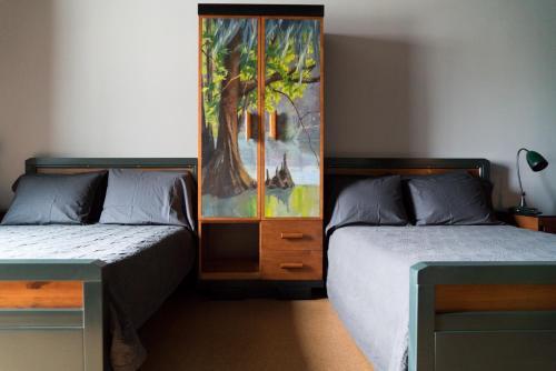 Un ou plusieurs lits dans un hébergement de l'établissement Ace Hotel New Orleans