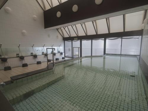 The swimming pool at or near Capsule Hotel The Inn