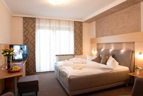 Ein Bett oder Betten in einem Zimmer der Unterkunft Dreilandhof