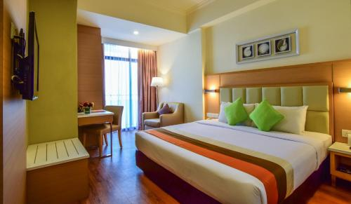 A bed or beds in a room at Hotel Sentral Seaview @ Beachfront