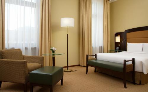 Кровать или кровати в номере Хилтон Москва Ленинградская