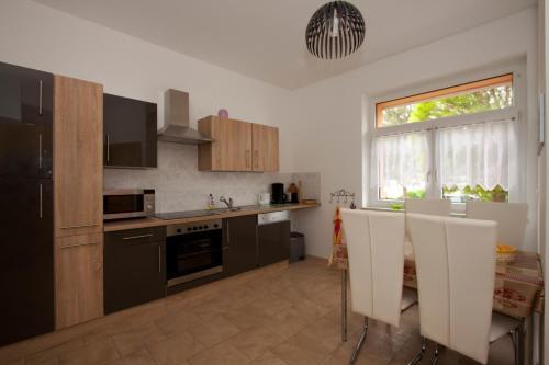 Küche/Küchenzeile in der Unterkunft Roßtrappensicht