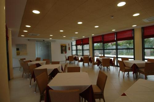 A restaurant or other place to eat at Elaia Garden Hotel