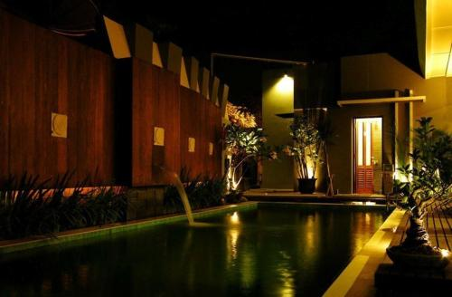The swimming pool at or near Savali Hotel