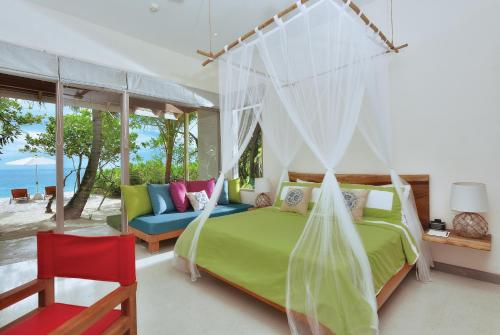 A bed or beds in a room at OBLU NATURE Helengeli-All-Inclusive with free Transfers