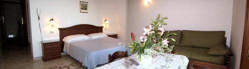 A bed or beds in a room at Ludovica Apartment Type B
