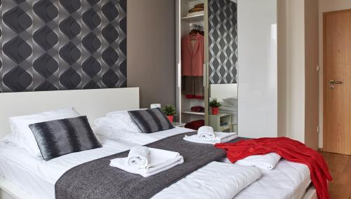 A bed or beds in a room at 7Seasons Apartments Budapest