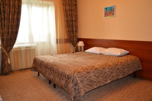 Кровать или кровати в номере На Высоте Отель