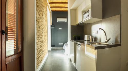 A kitchen or kitchenette at Soho Valencia
