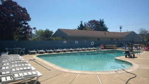 The swimming pool at or near Atlantic Motel