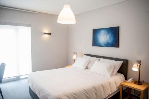 Un ou plusieurs lits dans un hébergement de l'établissement Agua d'Alma Hotel
