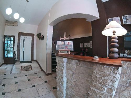The lobby or reception area at Les Palmiers