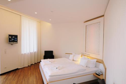Ein Bett oder Betten in einem Zimmer der Unterkunft Pension Havelfloß