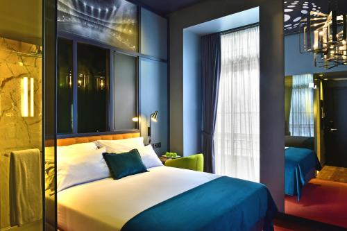 A bed or beds in a room at Pestana CR7 Lisboa