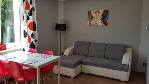 Część wypoczynkowa w obiekcie StudioSpanie Apartament Modern