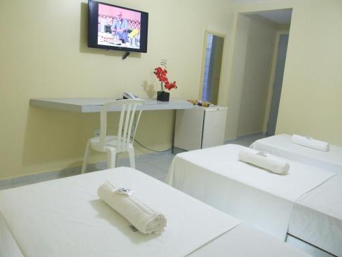 Кровать или кровати в номере JR Hotel