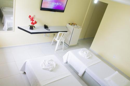 Телевизор и/или развлекательный центр в JR Hotel