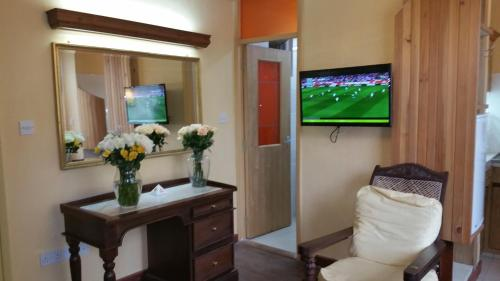 A television and/or entertainment center at Woodmere Serviced Apartment