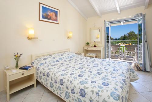Letto o letti in una camera di Alkioni Hotel