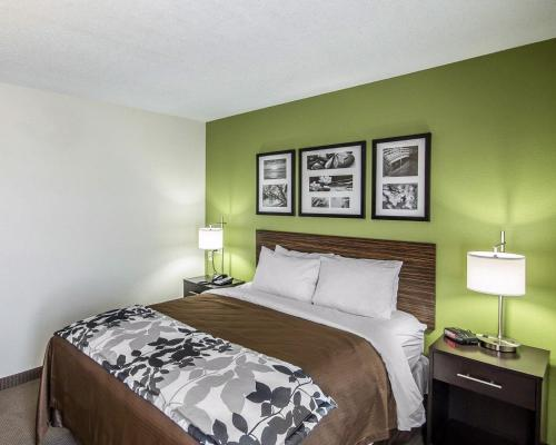A bed or beds in a room at Sleep Inn South Joplin