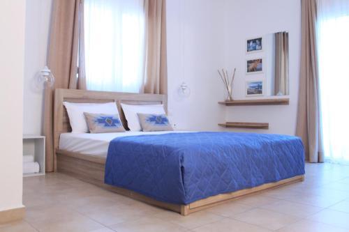 Un ou plusieurs lits dans un hébergement de l'établissement Krinis Apartments