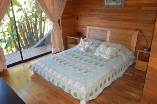 A bed or beds in a room at Cabañas el Retorno