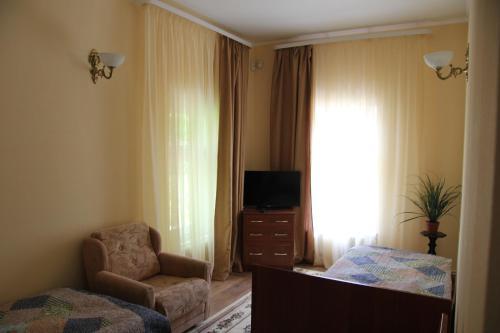 Телевизор и/или развлекательный центр в Гостевой Дом Павловых