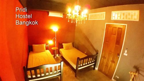 A bed or beds in a room at Pridi Hostel Bangkok