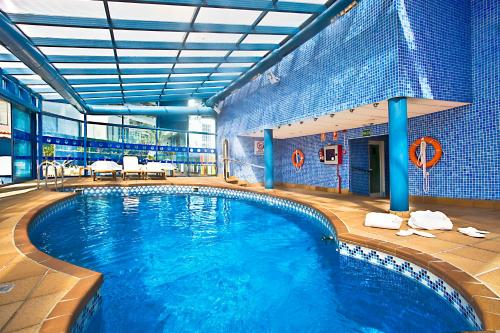 The swimming pool at or near Hotel Madeira Centro