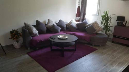 A seating area at Cite Espace Apartment