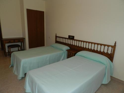 A bed or beds in a room at H. O CRISTO