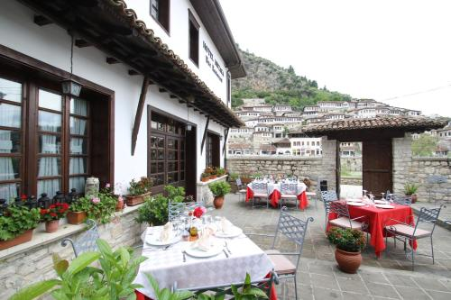 A restaurant or other place to eat at Boutique Hotel Muzaka (Historic Center)