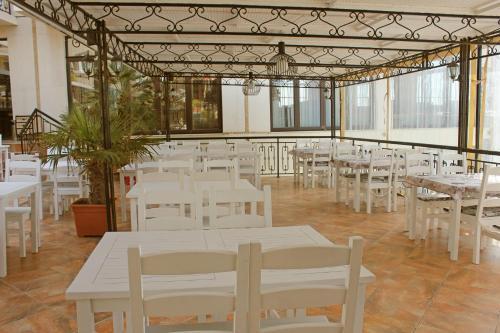 Ресторант или друго място за хранене в При Американеца Хотел