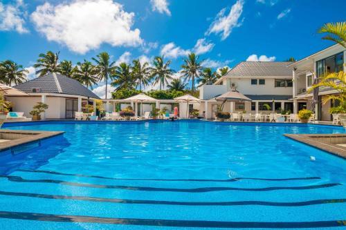 The swimming pool at or near Muri Beach Club Hotel