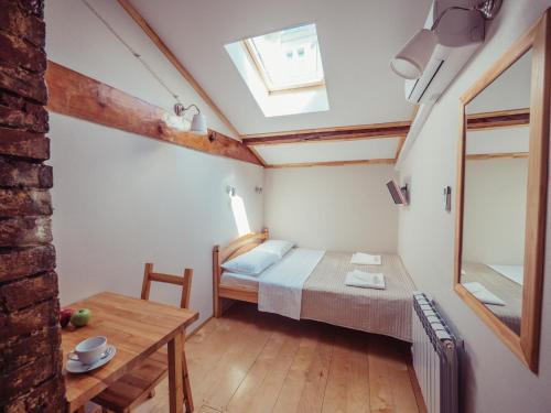 Кровать или кровати в номере Мини отель Чистопрудный