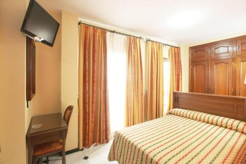Кровать или кровати в номере El Cisne