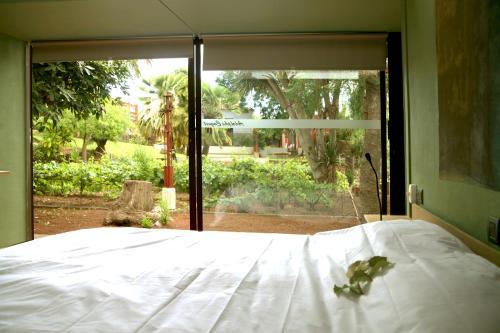 Cama o camas de una habitación en Hotel Emblemático Casa Casilda