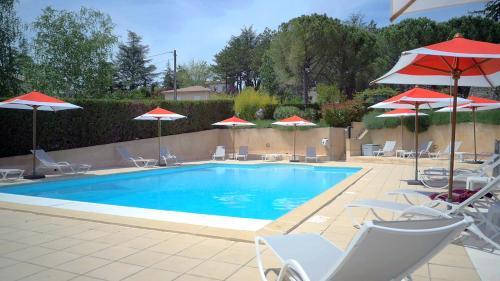 The swimming pool at or near Lou Paradou