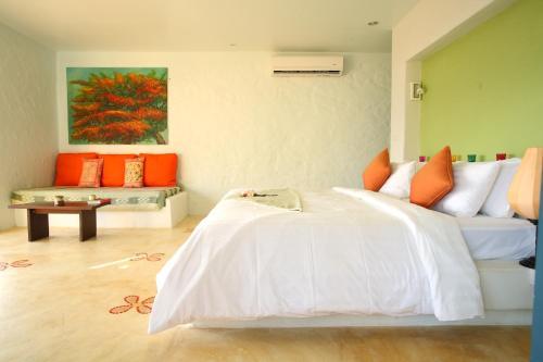 A bed or beds in a room at Vacation Village Phra Nang Lanta - SHA Plus