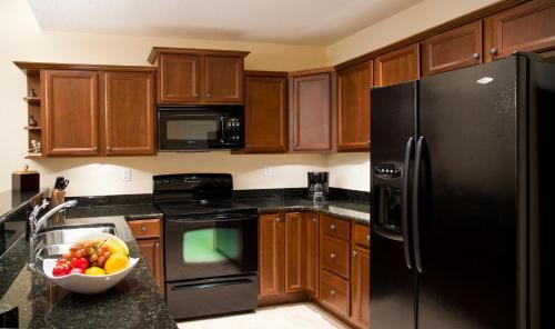 A kitchen or kitchenette at Emerald Greens Condo Resort