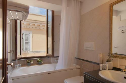 Un baño de Atlante Garden Hotel