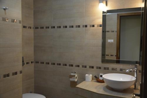 Ein Badezimmer in der Unterkunft Hotel Banderium