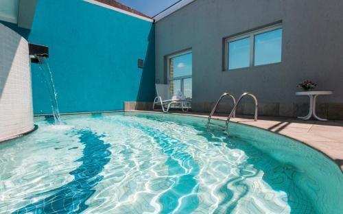 The swimming pool at or near Transamerica Executive Perdizes