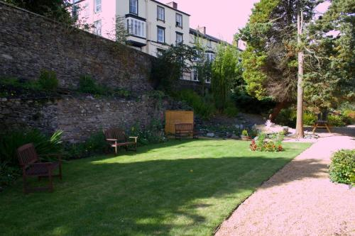 A garden outside The Hand Hotel