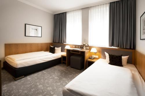 Ein Zimmer in der Unterkunft TOWNHOUSE Hotel