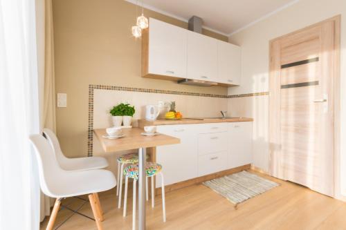 Kuchnia lub aneks kuchenny w obiekcie Domki Apartamentowe Bravo