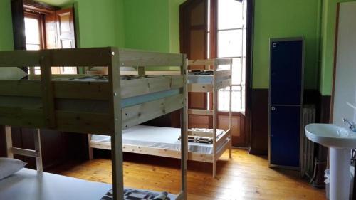 A bunk bed or bunk beds in a room at Albergue La Casona Del Peregrino