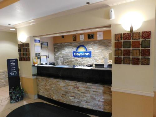 The lobby or reception area at Days Inn & Suites by Wyndham Cedar Rapids