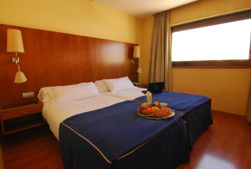 Una habitación en Hotel Galaico